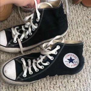 Black high top converse shoes